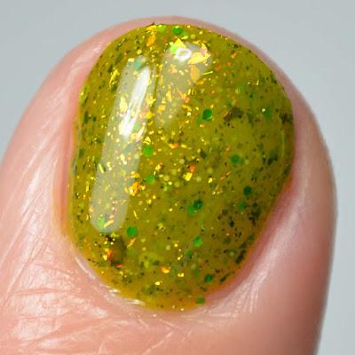 green glitter nail polish close up swatch