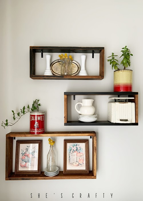 How to decorate wooden display shelves.