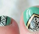 http://onceuponnails.blogspot.com/2014/04/tribal-toes.html