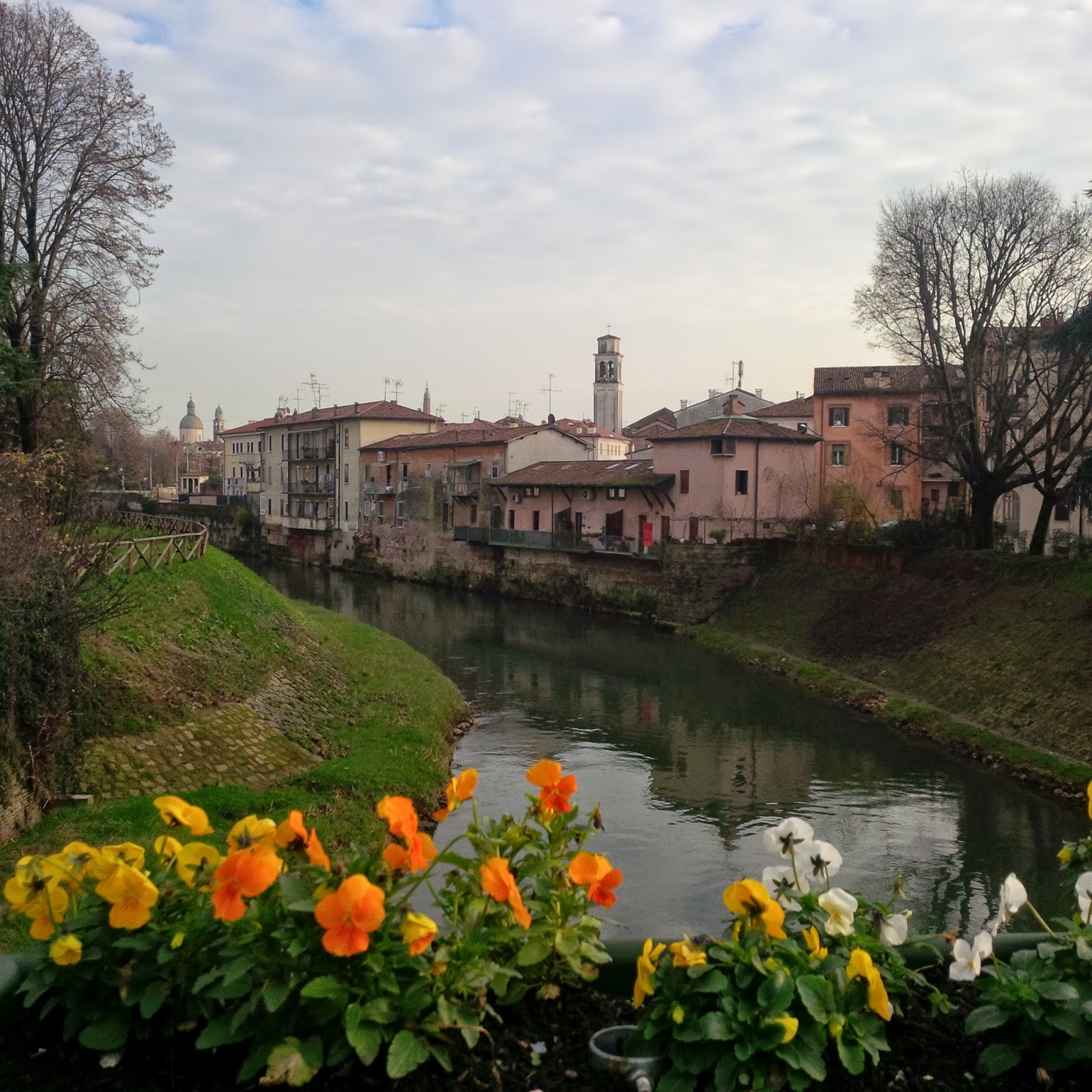 Flowers adorn the bridges above Vicenza's two rivers