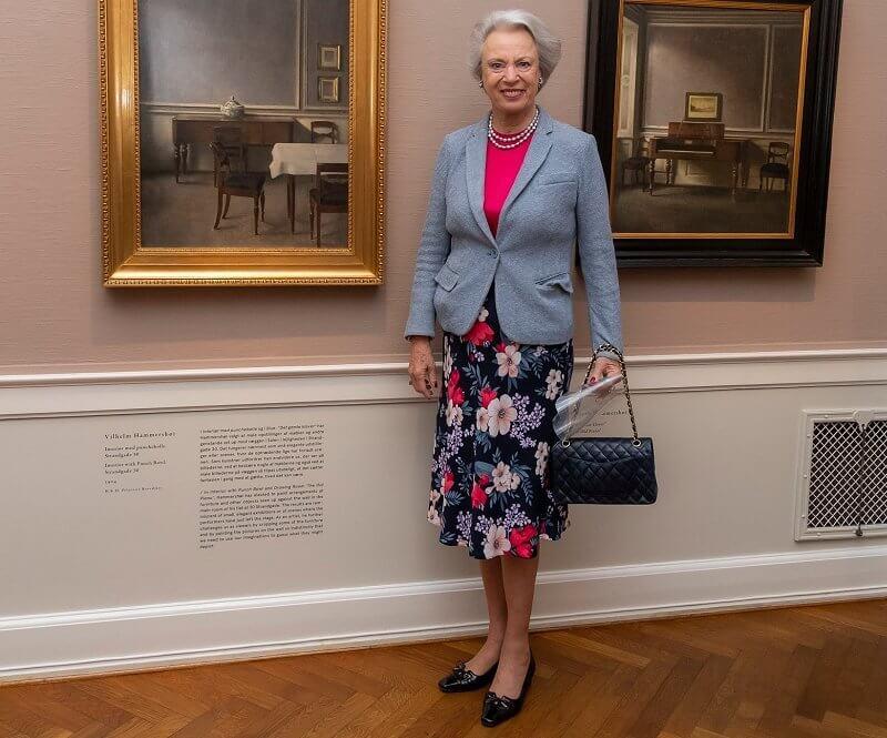 Hirschsprung Collection in Copenhagen. Princess Benedikte wore a grey blazer, pink sweater and floral print skirt. Chanel bag
