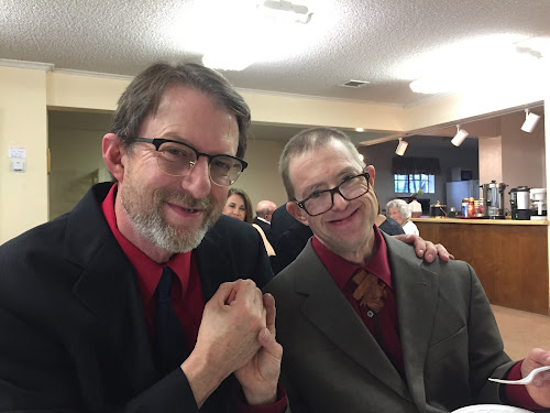 Dan and me at Dad's funeral, the last time I saw my little bro.