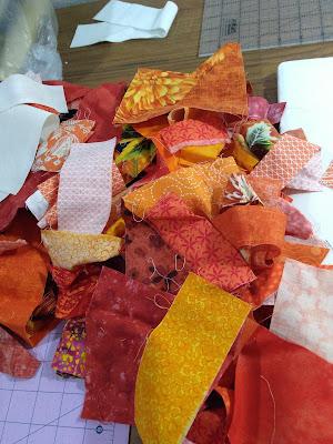 A pile of orange fabric scraps