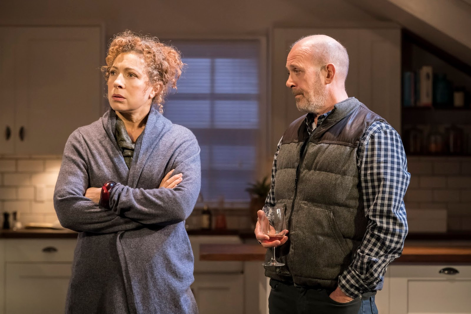 Actors Alex Kingston and Andrew Woodall act out a scene from the play Admissions