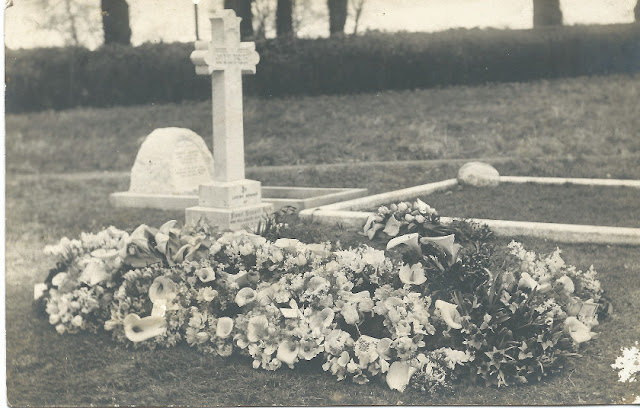 Grave with floral tributes in church yard