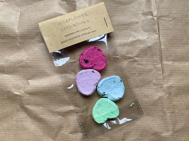 A packet containing 4 heartshaped wildflower seed bombs from Little Soap Bar