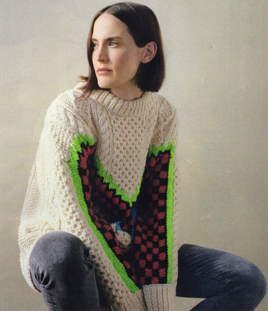 woman in chunky knit sweater and jeans