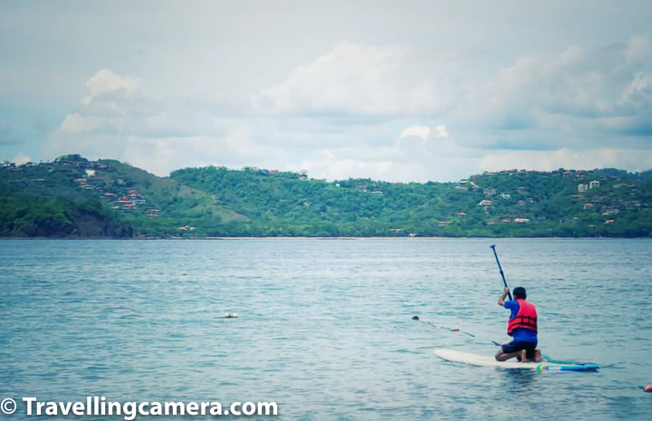 Related Blog-post from Costa Rica - Travel Guide for Monteverde Cloud Forest Reserve, Costa Rica - Pura Vida !  Blanca beach is more preferred for hosting parties by Four Seasons Papagayo Peninsula, as well as has plenty of water-sports options like paddle-boarding, kayaking, water-scooters, surfing etc. Above photograph shows me trying paddle-boarding although I gave up after a few minutes and returned back after a few meters into the bay. But it was still fun to paddle-board for few minutes around the beach.   Related Blog-post from Costa Rica - Things not to miss in & around Jaco Town of Costa Rica - Beaches, Birds & Landscapes
