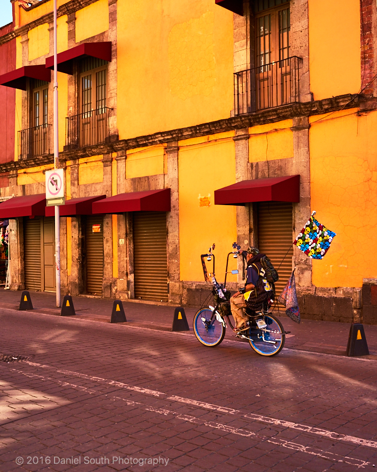 a photo of an oddly decorated bike in mexico city historic district
