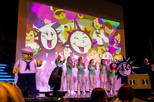 Staff from Doremi singing along to the theme song with characters