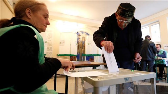 People in Georgia vote in round 2 of parliamentary polls