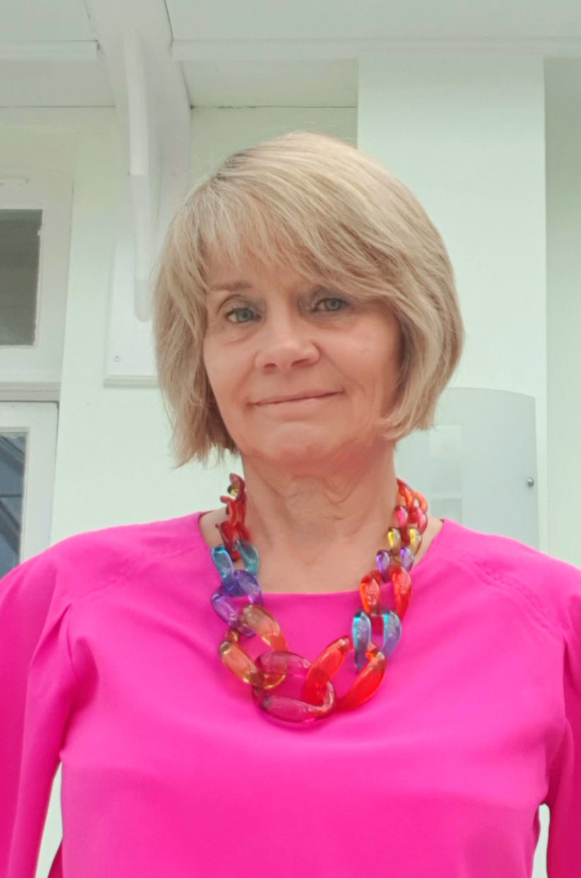 Decisions:  over 50s blogger Gail Hanlon originally paired this bright multicoloured necklace with a fuchsia top but then changed to layered pearls