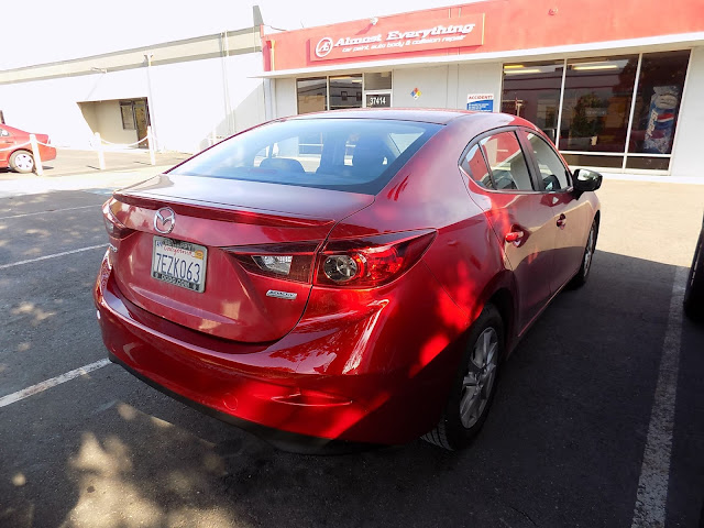 "Mazda 3 after repairs with tri-stage ""Soul Red"" paint at Almost Everything Auto Body."