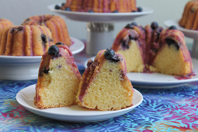 Food Lust People Love: Tender peachy crumb is perfectly complemented by the juicy blueberries with a hint of rosé wine in this buttery pound cake I'm calling Peach Rosé Blueberry Bundt. You can bake it as one cake in a 10-cup pan or as mini and small Bundts for sharing.