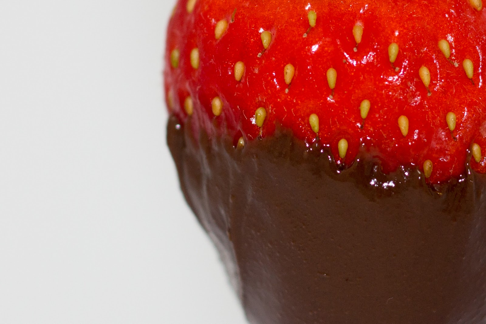 A close up of a big red strawberry dipped in Valsoia dairy free hazelnut chocolate spread