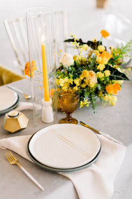 white and yellow reception table decor
