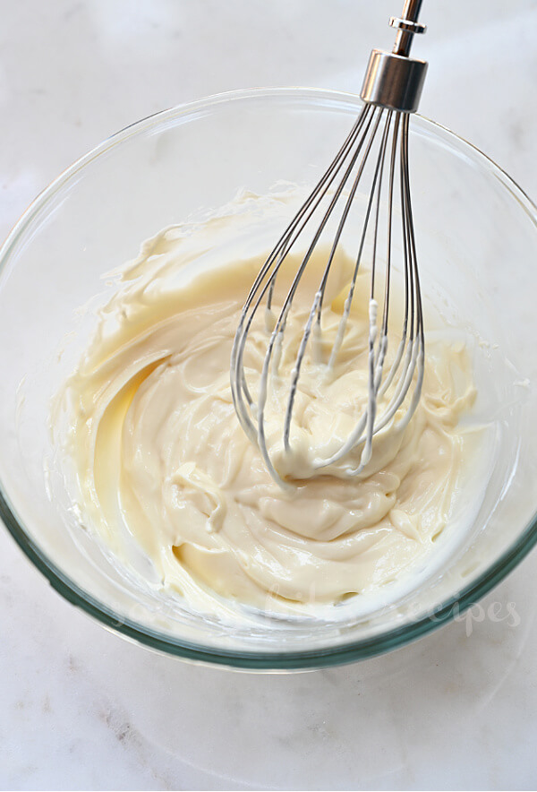 whisked cream cheese with sugar and vanilla