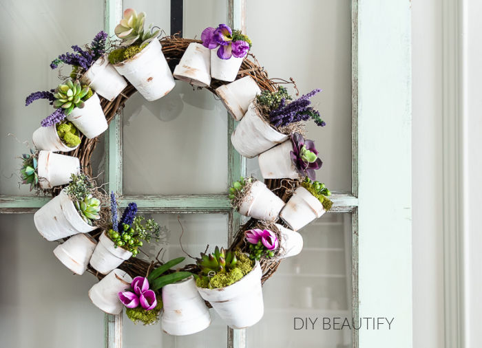 white flower pot wreath with flowers