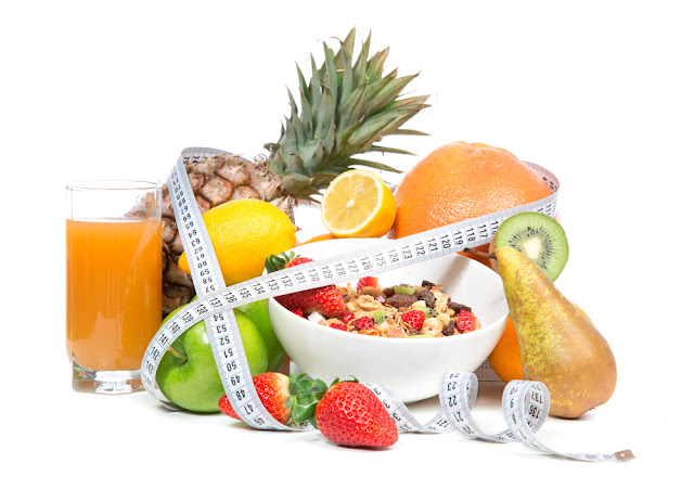 Diet weight loss breakfast concept with tape measure organic green apple, cereal bowl, orange juice, pineapple, muesli cereal bowl, pear, kiwi, lemon, strawberries