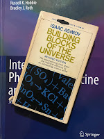 Building Blocks of the Universe, by Isaac Asimov, superimposed on Intermediate Physics for Medicine and Biology.