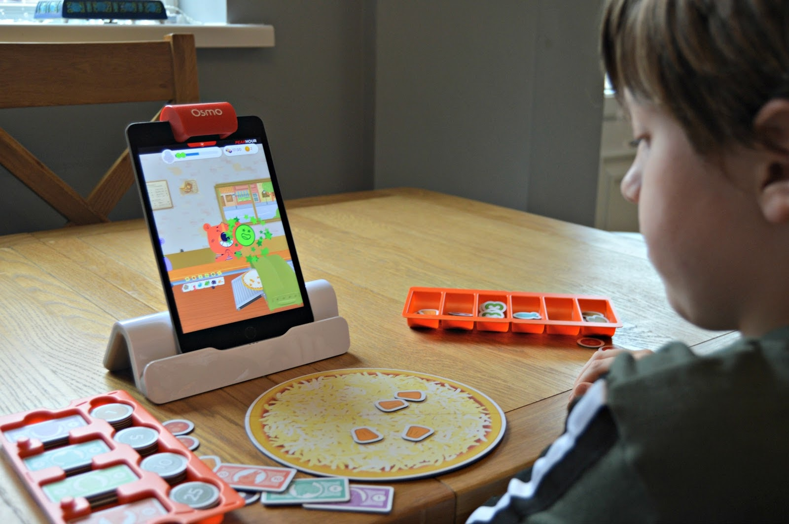boy playing osmo