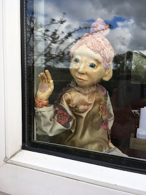 Poilin Puppet looking out the window  - Corina Duyn Puppets