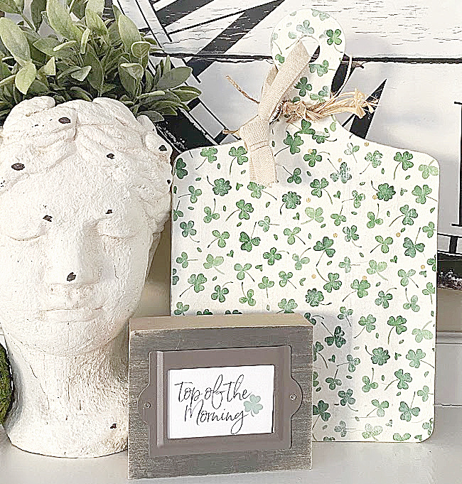 cement head, shamrock cutting board and top of the morning sign