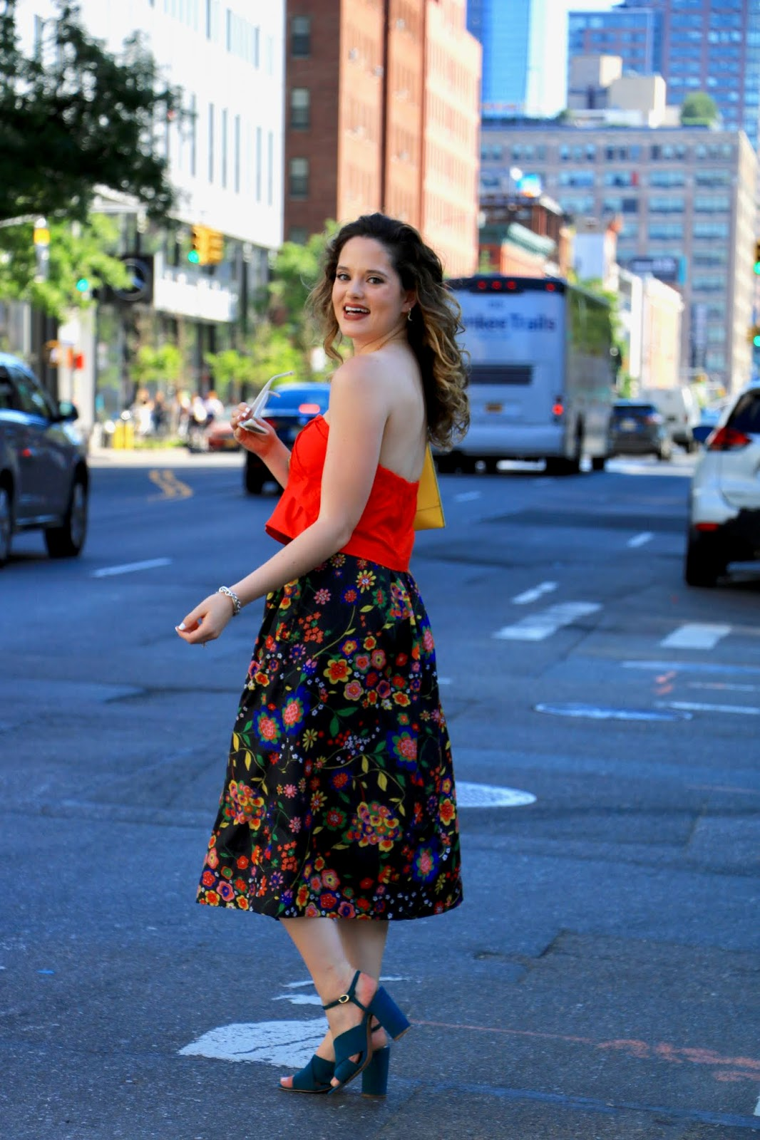 Nyc fashion blogger Kathleen Harper wearing a crop top outfit with a floral midi skirt.
