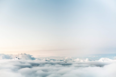Photo of pale blue clouds by Dominik Schröder on Unsplash