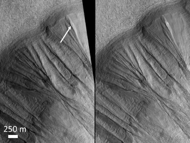 Melting dusty ice may have carved Martian gullies