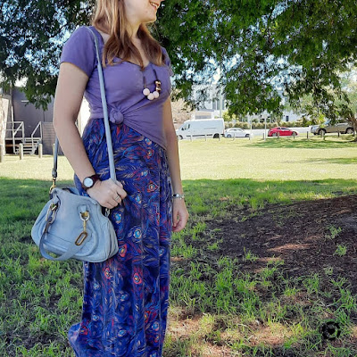 purple tee knotted over feather print maxi dress autumn outfit with small chloe paraty bag | awayfromblue Instagram