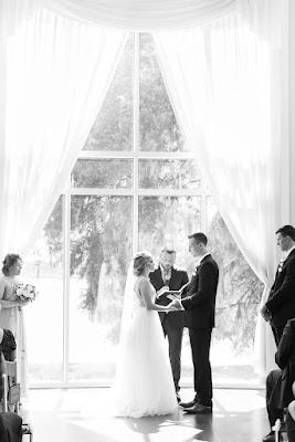 bride and groom in ceremony at lake mary events center rotunda