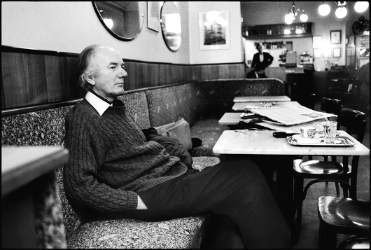 Thomas Bernhard at his usual ritual of reading newspapers