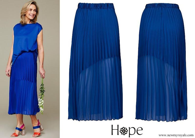 Kate Middleton wore a cobalt asymmetric contrast hem skirt by Hope Fashion