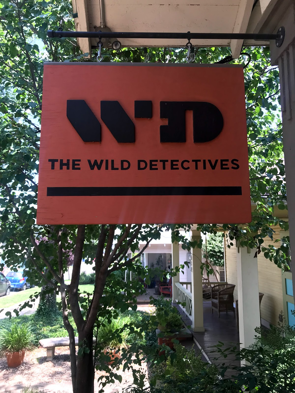 Image: Wild Detectives Sign At Coffe Shop in Oak Cliff Bishop Arts District