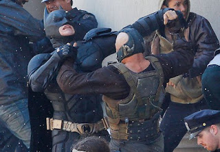 Batman being choked by Bane