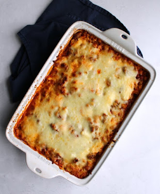 baked no boil pasta casserole fresh from the oven with golden melted cheese on top