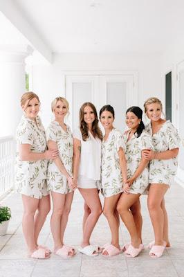 bride and bridesmaids in pajamas on wedding morning