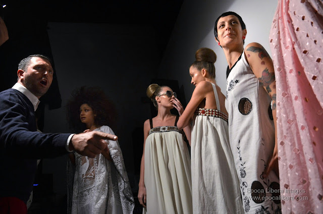 Fashion designer Panos Apergis orchestrates the exit of the models for the catwalk.