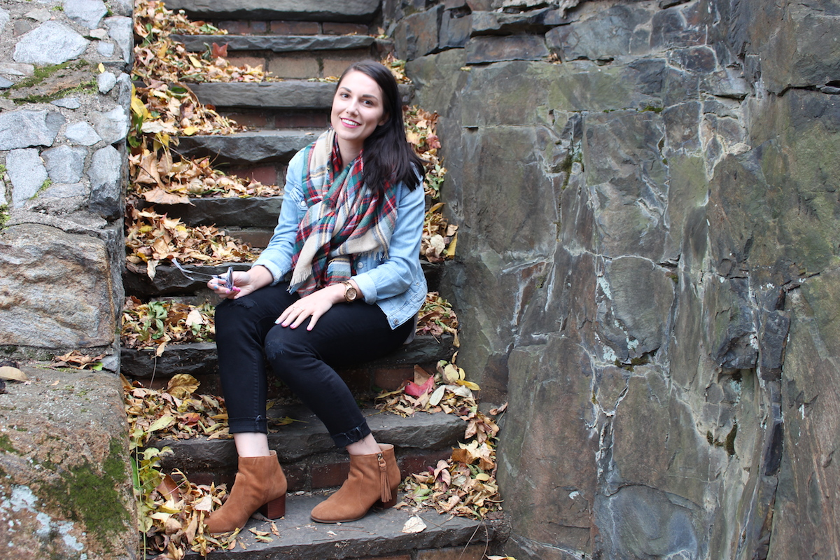 In this photo, I'm sitting on some stairs covered with leaves in my fall attire, in Wilmington Delaware.