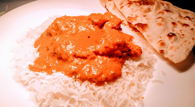 Chicken Tikka masala serving with rice and Naan