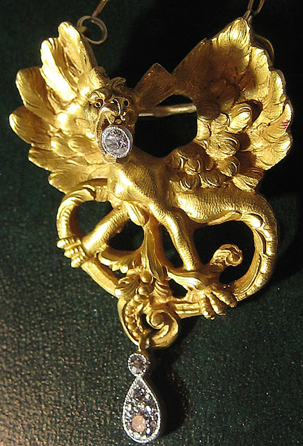 Art Nouveau gold and diamond griffin pendant necklace.