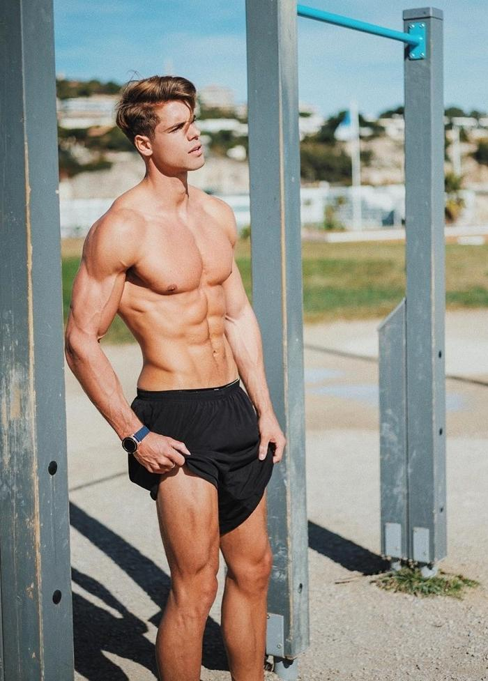 sexy-male-model-shirtless-slim-fit-body-pecs-abs-black-shorts-outdoor-gym-workout
