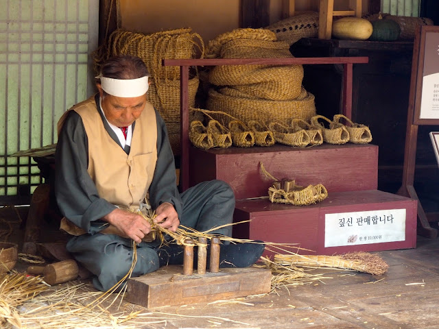 Making traditional straw shoes - demonstration and workshop in the Korean Folk Village, Yongin, Gyeonggi-do, South Korea