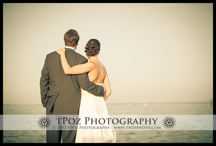 Bride & Groom overlook the waterfront at their Annapolis Maritime Museum Wedding