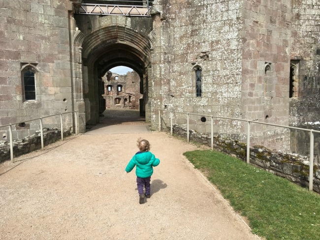 Raglan Castle - A toddler running towards doorway
