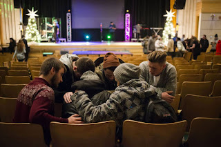 A group of young people pray together after a Christian City Church service in Toronto last month. The C3 Pentecostal movement, which originated in Australia, has spread to more than 450 churches around the world, including 11 congregations across Canada.