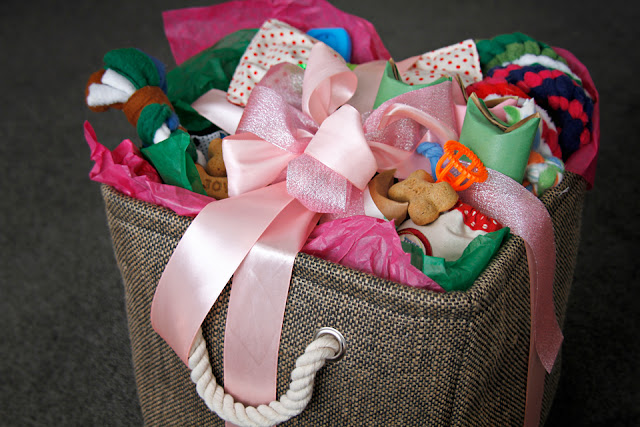 DIY dog gift basket full of toys, treats, and dog supplies