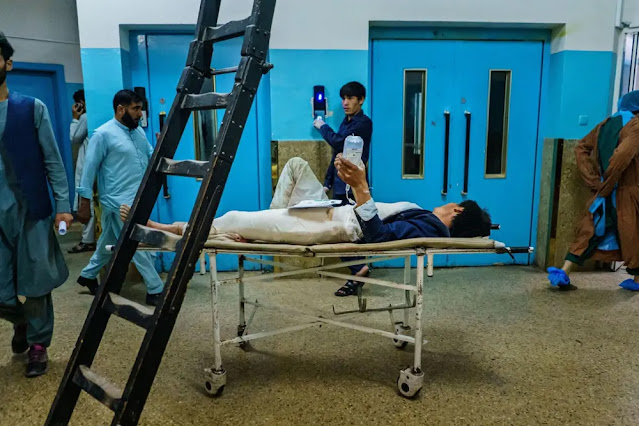 An injured patient waits to be transferred to a room at Wazir Akbar Khan Hospital. Photo: Los Angeles Times
