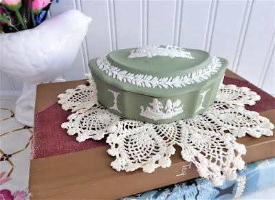 https://timewasantiques.net/collections/wedgwood/products/wedgwood-green-jasperware-lidded-box-1975-cherubs-domed-marquise-shape